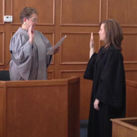 Photograph: Judge Renee Henke being sworn in as district magistrate judge.