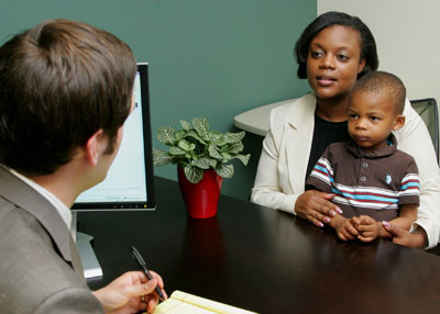 Photograph: Mother and children meeting with attorney.